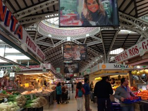 Each of the banners hanging down features the farmer/seller whose booth is located below.