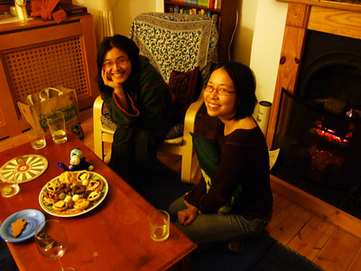 Oanh and Bek and a plate of Christmas cookies and mince pies.