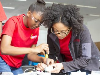 GIVING HIGH SCHOOL kids focused mentoring and hands on experience, ComEd mentors showed students from across Chicago how to provide solar power to people in need while they assembled Solar Suitcases.