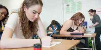 Melissa MacLellan, 15, left, and Erika Callahan, 16, prepare to take a test in Tomiko Robson's (far right) Grade 10 social studies class at Sir John Franklin High School on March 11, 2015. Department of Education, Culture and Employment officials say they plan to update the territory's health curriculum along with the legalization of marijuana next July. - NNSL file photo