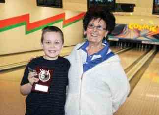 Ten-year-old Jacob Aylward receives the award as YBC Bowler of the Year in Hay River from coach Lillian Crook during a year-end event at Lizard's Lounge & Lanes on April 29. - Paul Bickford/NNSL photo