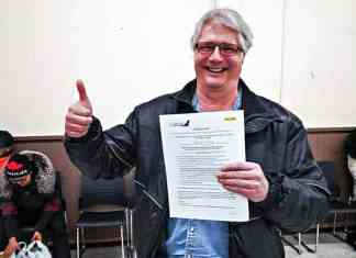 Jim MacDonald of Rankin Inlet gives a happy thumbs-up after having his ticket drawn for a pair if Calm Air tickets at the Rankin Rock peewee team's Penny Sale and Bake Sale fundraiser at the Rankin Inlet arena on Dec. 14, 2018. Photo courtesy Noel Kaludjak