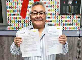 Patrick Kabluitok proudly displays the vouchers for a pair of Calm Air tickets after his name was drawn at the hamlet of Rankin Inlet's Christmas staff party in Rankin on Dec. 21, 2018. Photo courtesy hamlet of Rankin Inlet