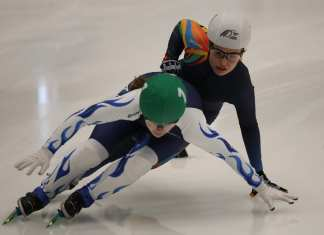 Wren Acorn tries to find her way around a Quebec skater during action in the girls 1,500-metre event at the Canada Winter Games in Red Deer, Alta., on Feb. 17. Rick Lawrence/Canada Winter Games photo