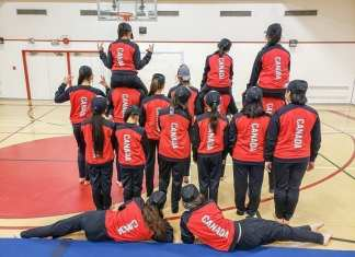 Members of the Rankin Inlet competitive gym team turn their backs to the camera to show what the backs of their new Team Canada uniforms will look like at the upcoming international World Gymnaestrada in Austria from July 7-13. Photo courtesy Lisa Kresky
