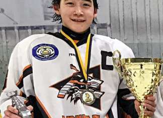 Garren Voisey of Arviat with MVP award at Bantam Rock championship in Rankin Inlet in March of 2018. photo courtesy Ryan St. John