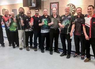 The top men's players from the NWT Darts Championships in Hay River show off their trophies following the completion of the tournament this past Sunday. They are, from left, Keith Way (Yellowknife), Elvis Beaudoin (Yellowknife), Danny Clouston (Yellowknife), Paul Morey (Inuvik), Sheh Murillo (Yellowknife), Joe Laba (Yellowknife), Norm Sanderson (Yellowknife), Tim Griffin (Yellowknife), Dan Kipling (Hay River), Paul Power (Hay River) and Max Kotokak (Inuvik). photo courtesy of Randy Thompson