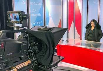 Arviat Film Society member Elena Akammak gets to try on the CBC's TV studio for size while in Iqaluit to attend the Nunavut film conference on March 12-13, 2019. Photo courtesy Eric Anoee
