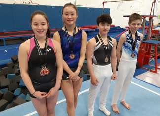 Four members of the Yellowknife Gymnastics Club came home from the University of Calgary International Cup competition last weekend with some new neckware. They are, from left, Emma Leathem, Jade Ko, Ty Leathem and Noel Barrichello. James McCarthy/NNSL photo