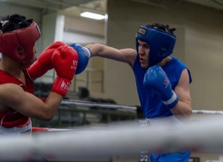 Hay River's Jesse Mackie, right, is an amateur boxer now living in Grande Prairie, Alta. In March, he won his only bout at the Alberta Provincial Boxing Championships in Leduc. His opponent was Jerico Aringo of Slave Lake. Photo by Dean Rumpel