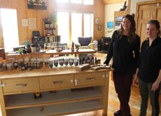 Amy Maund, right, founder of Laughing Lichen and Courtney Davison, operations supervisor, next to a sample of the wide range of wildcraft products made in Maund's off-grid home outside of Yellowknife. Maund has been using her lifetime or foraging skills and knowledge to build her company from once being at a farmers market to selling products across Canada. Brett McGarry NNSL/Photo