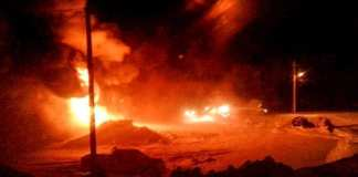 Flames light-up the darkness as a horrific fire rips through the Hamlet 6 municipal bay garage in Baker Lake during the early morning hours of Jan. 29. photo courtesy of Hamlet of Baker Lake