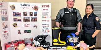 Bylaw officer and firefighter Capt. Kyle Lowe and medic Grachel D'Cuhna, right, represent the Rankin Inlet Fire Rescue EMS at the annual health fair at the community hall in Rankin on May 7, 2019. Photo courtesy Mark Wyatt.