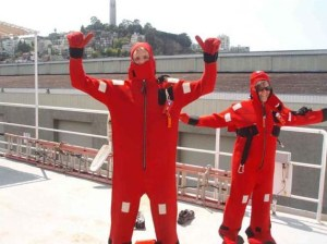 Justin Czarka and Morgraine McKibben try on their survival suits during drills aboard the McArthur II.