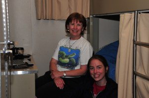 Jana on floor next to Sue in chair in stateroom