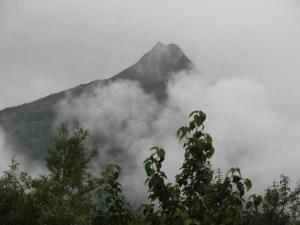 Mountain Peak Through The Fog