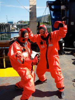 """Safety Stand Down Day:"" Staci and I don orange gumby survival suits... ...and jump off the side of the ship into the water..."