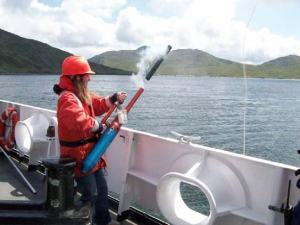 Practicing using the line launching device.  This tool is helpful in getting help to a man overboard quickly and efficiently.