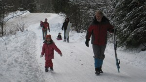 Jess, Josh, and family sledding with Grampie