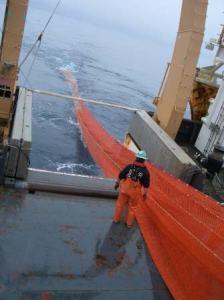 Nate, a fisherman, works the trawl net