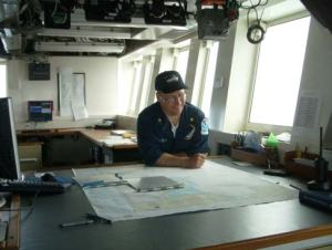 NOAA's Lieutenant Commander D. ZezulaReading the chart of the North Bering Sea