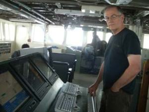 Chief Scientist, Paul Walline, monitoring the echogram from the bridge of OSCAR DYSON.