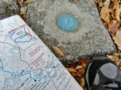 Checking the trail map and USGS marker on Pine Mountain