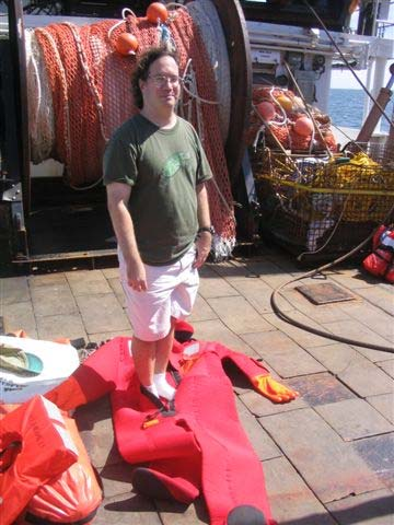Robert Gambel, scientist, standing in front of our fishing net ready to put on his survival suit