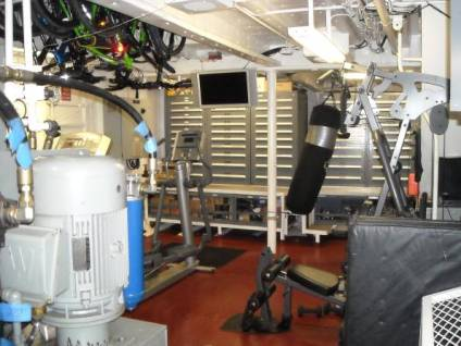This room has many drawers that contain thousands of different parts and fittings for all over the ship.  It also has the exercise equipment.