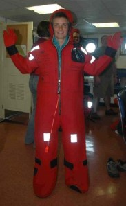 "NOAA Teacher at Sea Elizabeth Eubanks models the abandon ship suit, also known as a ""Gumby"" suit."