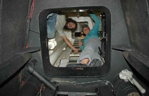 Doctoral student Dovi Kacev and NOAA Teacher at Sea Elizabeth Eubanks look down into the bow chamber.