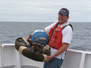 Dave holding the drifter buoy