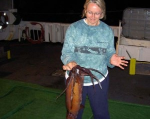 NOAA Teacher at Sea, Sue White, holds a live Humboldt squid!