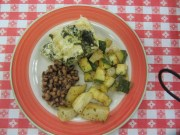 Spinach lasagna roll, squash and onions, black eye peas, and roasted potatoes