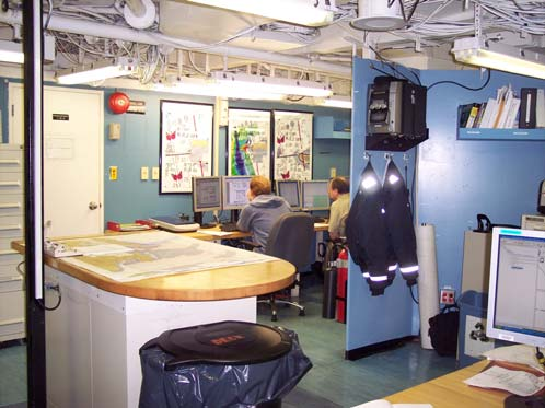 Seaman Surveyors Doug Wood and Peter Lewit interpret hydrographic data in the survey room