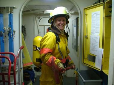TAS Braun suits up in fire gear.
