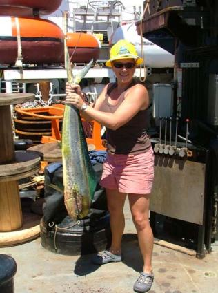 TAS Braun holds up the catch of the day, a mahi mahi!