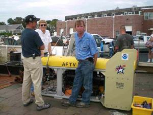 Chief Scientist Bill Michaels (right) with his new Advanced Fisheries Towing Vehicle, used for the first time on this hydroacoustic survey. It uses fiberoptic cables to send real-time images to the ship's computer.