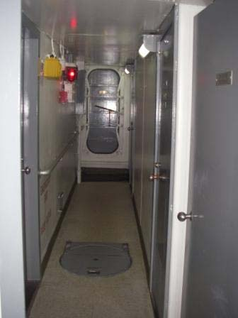 View of a passage (hallway) aboard the RAINIER.  My stateroom is on the right