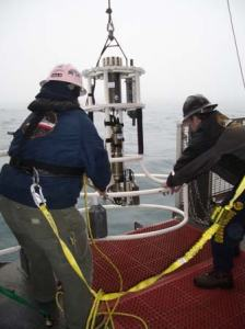 Senior Survey Technician Colleen Peters and crewmember Dennis Boggs recover the CTD equipment.