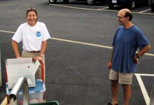 Amy Pearson helping Chief Scientist Jerry Prezioso load equipment onto  DELAWARE II