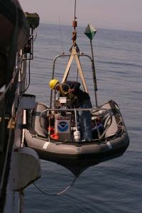 Dr. Richard Pace assists with deployment of the zodiac.