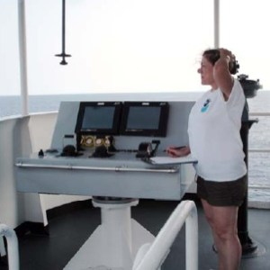 NOAA Teacher at Sea Miriam Hlawatsch attempting to read sea swells and sea wave height from the Bridge.