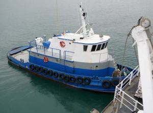 Tug boat St. Augustine helps the Fairweather pull out
