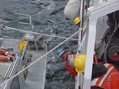 several of the deck crewmembers recovering RA 1 back to the RAINIER for the day.