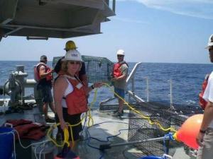 Nancy stands by with buoy line as other members of the NOAA team stand by for deployment of the fish trap.  The fish trap is retrieved approximately two hours later.