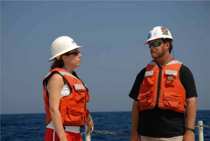 Andy David, Principle Investigator, confers with Stacy Harter, Fisheries Bilogogist, on strategies for the day's mission.
