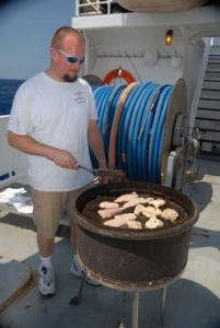 "Patrick ""Cookie"" Downey grills up some freshly caught dolphin fish."
