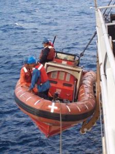 A small boat is launched in order to get to the stratus buoy