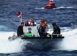 The NF4 (shown in front) is transporting divers back to the ship after a successful dive. The RHIB (shown behind) carries an oxygen manifold that delivered pure oxygen to the divers during their ascent from the ocean floor.
